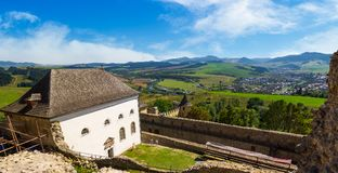 View in to the valley fro the castle wall. Stara Lubovna, Slovakia - AUG 28, 2016: view in to the valley from the castle wall. lovely countryside landscape with Royalty Free Stock Image