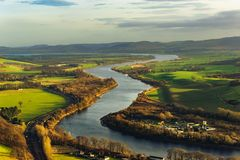 A view to river Tay from Kimmoull hill, Perthshire, Scotland. A view to the valley of the river Tay from Kimmoull hill, Perthshire, Scotland in golden snset Royalty Free Stock Photos