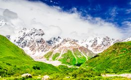 View to the valley of Shkhara Glacier with Shkhara, the highest mountain in Georgia behind Svaneti, Caucasus stock photos