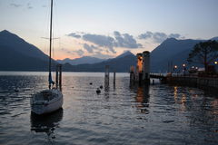 View to Varenna pier at sunset Stock Images