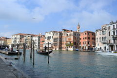 View to Venice canal with gondola and motorboat transporting tourists Royalty Free Stock Photography
