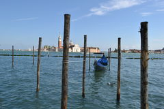 View to Venice lagoon infront of San Marco square and gondola anchored Stock Photos