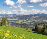 View to villages surrounded by forests, water and mountains. Bavaria. Royalty Free Stock Photos
