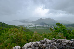 The view to the village Virpazar and Skadar Lake. From the stone view-point at a rainy evening at Montenegro Royalty Free Stock Image