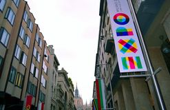 View to Vittorio Emanuele main street and Duomo of Milan with expo 2015 panel close-up. Royalty Free Stock Images