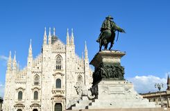 View to Vittorio Emanuele monument and Duomo of Milan in sunny summer day. Stock Photos