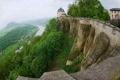 View to the walls and buildings of the fortress of Koenigstein and Elbe river in Saxony, Germany. royalty free stock image