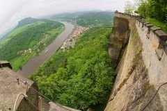 View to the walls and buildings of the fortress of Koenigstein and Elbe river in Saxony, Germany. royalty free stock photo