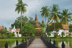 View to the Wat Traphang Thong with the bridge over a pond at the foreground in Sukhothai, Thailand. Stock Images