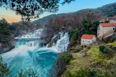View to the waterfalls and the mills on Krka. Cascade of the waterfalls on river Krka and old mills that are using their power. Photo taken in spring of 2017 Royalty Free Stock Photos