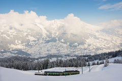 View to the Wengernalpbahn railway train passing by the valley in Grindelwald, Switzerland. Royalty Free Stock Image