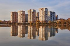 View to the west of Krasnodar from the Kuban River in the winter at golden hours. New high-rise buildings and their reflection in stock photo