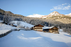 View to a winter landscape with old farmhouse and mountain range, Gasteinertal valley near Bad Gastein, Pongau Alps - Salzburg Aus Stock Photography
