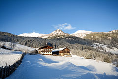 View to a winter landscape with old farmhouse and mountain range, Gasteinertal valley near Bad Gastein, Pongau Alps Royalty Free Stock Photo