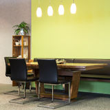 View to wooden table with leather chairs Stock Photo