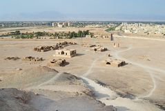 View to the Zoroastrian temples ruins and Yazd city from the Tower of Silence in Yazd, Iran. Royalty Free Stock Photos