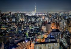 View of Tokyo by night with Skytree in the center. Tokyo capital of Japan, cityscape by nigh with skyscrapers and all different lights colours of the night Stock Image