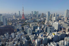 View of the Tokyo Tower with many buildings Stock Image