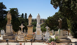 View of the tombstones, statues back to the viewer. View of the old tombstones, statues back to the viewer Royalty Free Stock Image