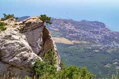 View from the top of the Ai-Petri mountain to the coastal city and the Black Sea. Crimea royalty free stock photography