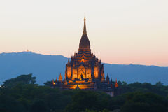 A view of the top of the ancient Buddhist temple off the Gawdaw Palin in the background of the twilight sky. Bagan, Burma Royalty Free Stock Image