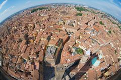 View from the top of Asinelli tower with a fish eye lens to Bologna, Italy. Royalty Free Stock Photos