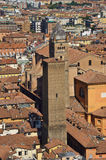 View from top of Asinelli Tower. Looking out of one of the windows of the tallest tower in Bologna, the Asinelli Tower looking out over the city at some a couple Stock Photo