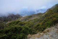A view from the top of Baru Volcano, Panama to the valley with white fog in the distance Stock Images