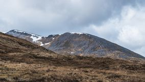 View at the top of Ben Nevis. Range and Gondola, Scotland. some ice still visible during Spring time stock images