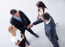 View from the top. business partners shake hands. Stock Photos