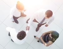 View from the top. business team discussing business issues Stock Images