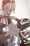 View from the top. business team holds a briefing. Brainstorming.business team discussing a financial plan stock images