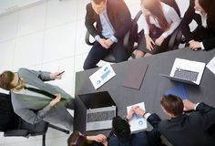 View from the top. business team holds a briefing. Brainstorming.business team discussing a financial plan royalty free stock photo