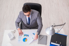 The view from top on businessman working on business charts Stock Photo