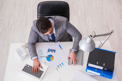 The view from top on businessman working on business charts Stock Photography