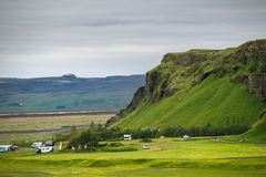 View from the top of a cliff near Seljalandsfoss Waterfall, Icel. And Stock Images