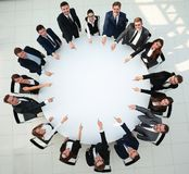 Closeup .business team pointing in the center of the table. Stock Photos