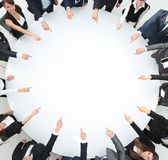 Closeup .business team pointing in the center of the table. stock photography