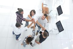 Creative team giving each other a high five. View from the top.creative team giving each other a high five.photo with copy space royalty free stock photos