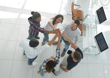 Creative team giving each other a high five. View from the top.creative team giving each other a high five.photo with copy space royalty free stock photo