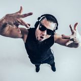 View from the top - DJ - rapper with headphones on a light background stock image