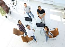 Employees of travel agencies standing in office. View the top employees of travel agencies standing in office and looking at camera Royalty Free Stock Photo