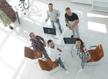 Employees of travel agencies standing in office. View the top employees of travel agencies standing in office and looking at camera Stock Images