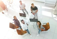 Employees of travel agencies standing in office. View the top employees of travel agencies standing in office and looking at camera Royalty Free Stock Images