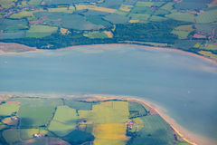 View from top on Essex with River Crouch and mosaic fields and m. Eadows. Horizontal full frame crop with river in middle Stock Image