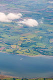 View from top on Essex with River Crouch and mosaic fields and m. Eadows. Verticall full frame crop with river at the bottom Stock Image