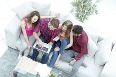 View from the top. friends watching video on the laptop Stock Image