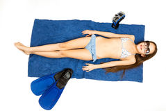 View from top on girl in sunglasses sunbathing on blue towel Royalty Free Stock Image