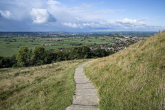 View from top of Glastonbury Tor overlooking Glastonbury town in. Landscape view from top of Glastonbury Tor overlooking Glastonbury town in England royalty free stock photo