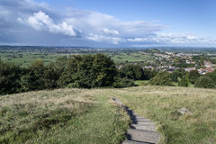 View from top of Glastonbury Tor overlooking Glastonbury town in. Landscape view from top of Glastonbury Tor overlooking Glastonbury town in England Stock Photography
